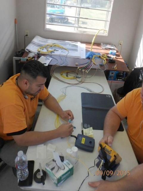 Fusion splicing and testing of fiber optic cable (September 2015)