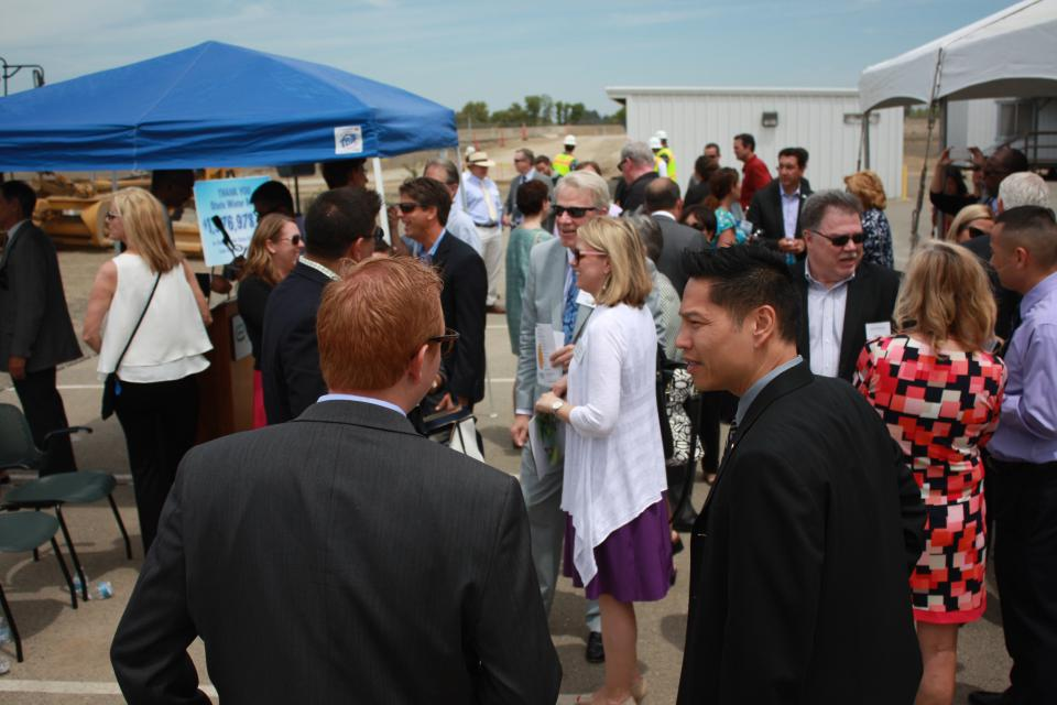 Elk Grove Council Member Darren Suen (foreground, right)