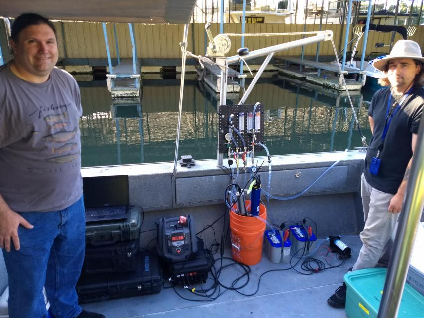 "Tim Mussen and James Noss with high-frequency water quality mapping system onboard the Regional San vessel ""Guardian."" Photo: Lisa Thompson)"