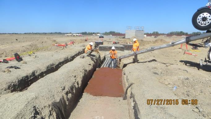 Pouring concrete for the duct bank encasement (July 2015)