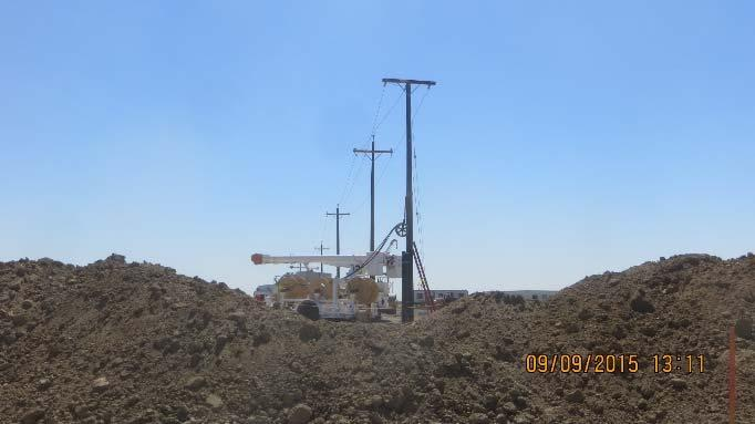 Stringing overhead wiring along new power poles (September 2015)