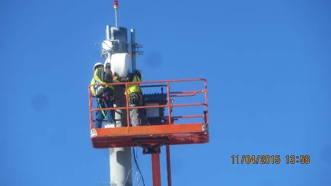 Microwave dish installation on tower at NCA field office (November 2015)
