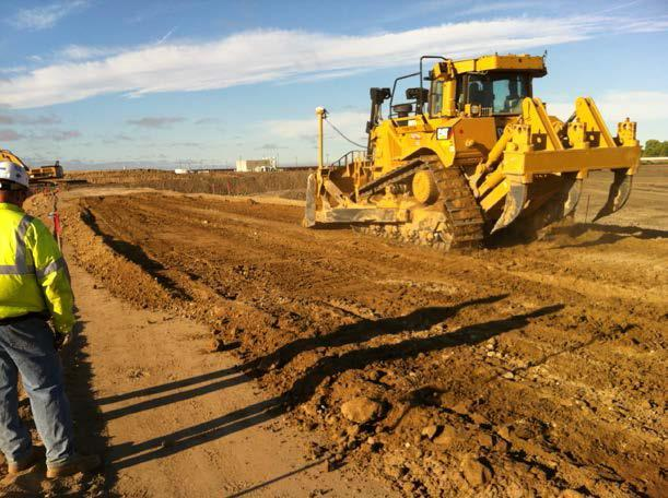 Bulldozer at work at a pilot compaction test area on an intermediate levee for the Flow Equalization Project (July 2015)